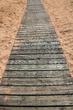 Wooden path in sand Stock Image