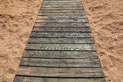 Wooden path in sand Royalty Free Stock Photo