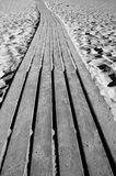 Wooden path through a sandy beach Stock Photos