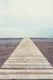 Wooden path at the sea edge Stock Images