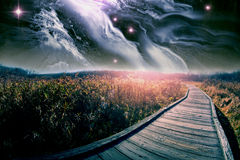 Wooden Path Star Scape. Wooden path through field with majestic star scape Stock Image