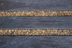 Wooden path. Wooden path in the stones lawn Royalty Free Stock Photos