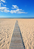 Wooden path to the beach Stock Photos