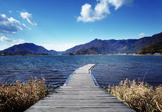 Wooden path to lake Stock Image