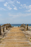 Wooden path to the sea Royalty Free Stock Photography