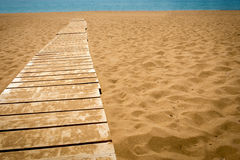 Wooden path to the sea Stock Image