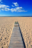 Wooden path to the sea Stock Photo