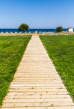 Wooden path to the sea Royalty Free Stock Images
