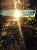 Wooden path to swimming pool. Nice wooden path to swimming pool with beautiful sun light Royalty Free Stock Photography
