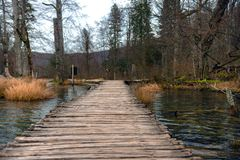Wooden path trough the lakes Stock Photo