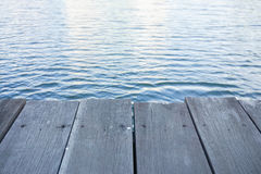 Wooden pathway along riverside. Close up wooden pathway for sitting along riverside Royalty Free Stock Image