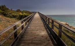 Wooden pathway on beach during afternoon royalty free stock image