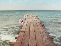 Wooden pathway with forbidden swimming signal Royalty Free Stock Image