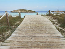 Wooden pathway on a Mediterranean beach Royalty Free Stock Photography
