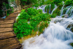 Wooden pathway near waterfalls Royalty Free Stock Photos