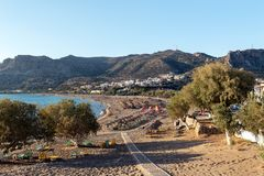 Wooden pathway to sandy beach at Palaiochora town at southern part of Crete island, Greece. stock photography