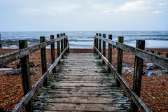 Wooden pathway on Worthing beach royalty free stock image