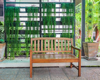 Wooden patio bench Royalty Free Stock Photo