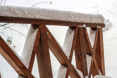 Wooden patio deck railing covered in snow Stock Photo