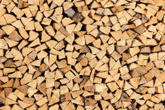 Wooden pattern. A pile of cloven wood Royalty Free Stock Photo