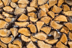 Wooden pattern. Stack of firewood at winter Stock Photos