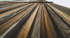 Wooden pattern wall extrioor of a building stock image