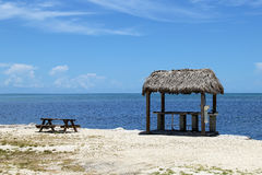 The wooden pavilion and bench on the beach and blue sky. Oi Islamorada island, Florida keys Stock Photos