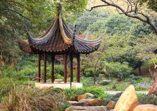 Wooden pavilion in the chinese garden. Tiger Hill, Suzhou, China. Wooden pavilion in the chinese garden. Tiger Hill, Suzhou, China Royalty Free Stock Photography