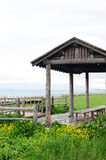 Wooden pavilion and fence in the grassland Stock Image