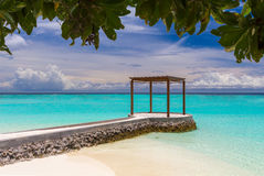 Wooden pavilion at Maldives. In front of Indian ocean Royalty Free Stock Images