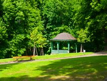 Wooden pavilion in the park Stock Photos