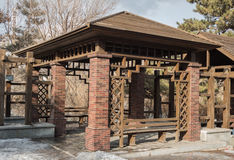 Wooden pavilion. For rest of the pavilion in the park, brick hybrid structure Stock Photo