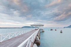 Wooden pavilion and walkway leading to ocean Stock Photos