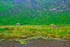 Wooden pavilion and wooden bridge in lotus lake, Samroiyod natio Stock Photos