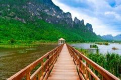 Wooden pavilion and wooden bridge in lotus lake, Samroiyod natio Stock Photography