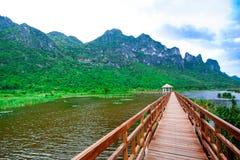 Wooden pavilion and wooden bridge in lotus lake, Samroiyod natio Royalty Free Stock Image