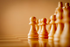 Wooden pawn in a chess game Royalty Free Stock Photos