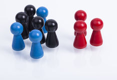 Wooden pawns isolated. A pile of wooden pawns with color red,blue and black Royalty Free Stock Photography