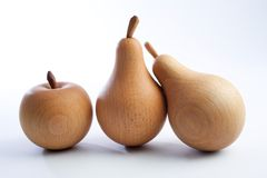 Wooden pears with an apple Stock Images