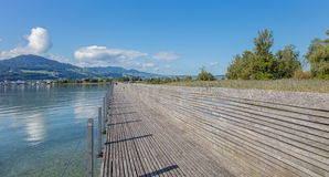 Wooden pedestrian bridge over the Lake Zurich Royalty Free Stock Images