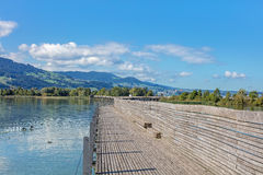 Wooden pedestrian bridge over the Lake Zurich Royalty Free Stock Image