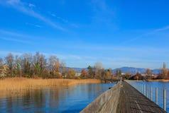 Wooden pedestrian bridge over Lake Zurich in Switzerland Stock Image