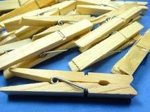 Wooden peg. On blue background stock image