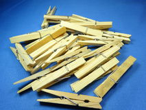 Wooden peg. On blue background royalty free stock photography
