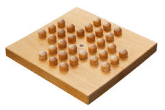 Wooden peg solitaire board or brainvita Royalty Free Stock Image