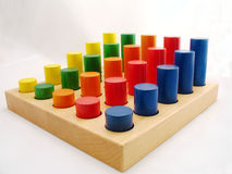 Wooden pegs. In primary colors Royalty Free Stock Photos