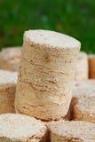 Wooden pellets Stock Images