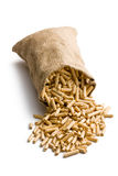 Wooden pellets in jute sack Stock Images