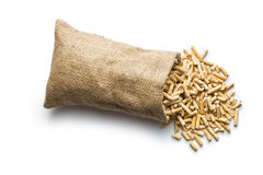 Wooden pellets in jute sack Stock Photography
