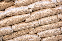 Wooden pellets in sacks Royalty Free Stock Images